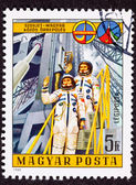 Stamp Waving Astronauts Launch Tower Space Suit — Stock Photo