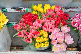 Bouquet of Flowers Tulips in a Old Metal Flourist Display — Stock Photo