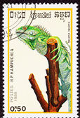 Canceled Cambodian Postage Stamp Green Lizard, Iguana Gripping T — Stock Photo