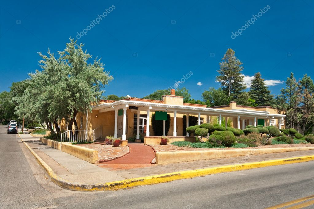 Mid century modern ranch besides taos pueblo new mexico villages