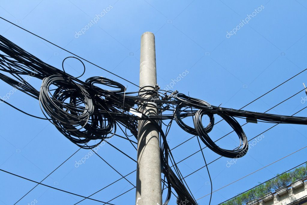 Mass of Telephone Electrical Wires On Cement Pole Shanghai China.  Often in China each individual apartment or office hooks up its own telephone and electric li  Stock Photo #7896168