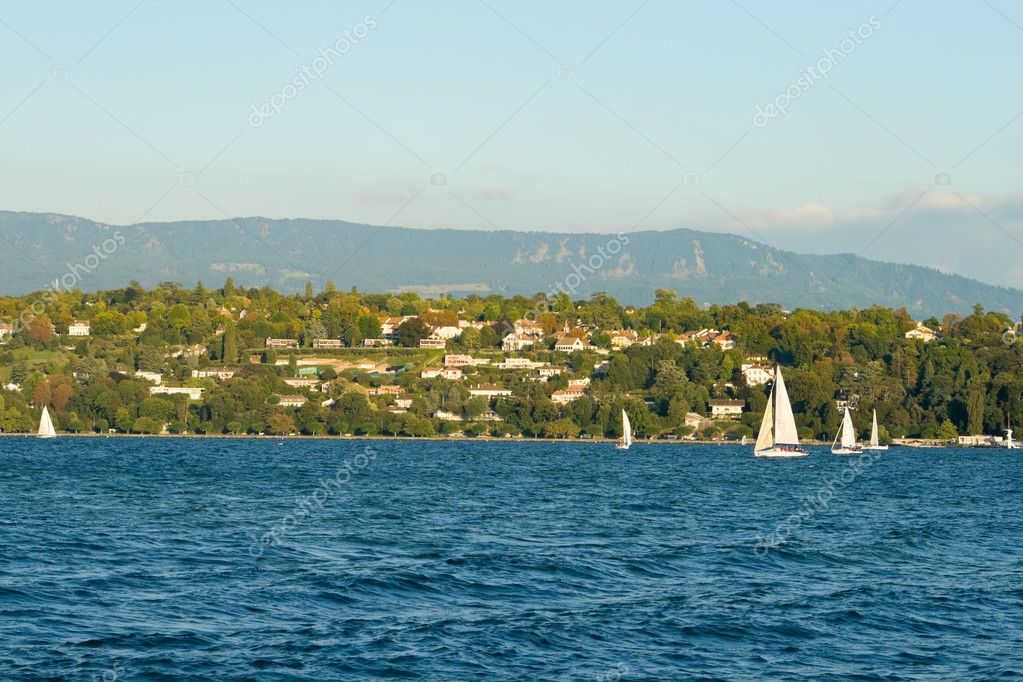 Luxury homes overlooking sailboats on Lake Geneva, Switzerland.  Stock Photo #7896318