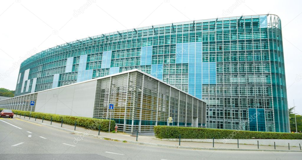 Modern glass building World Meteorological Organization, WMO, Geneva Switzerland.  Wide angle lens. — Stock Photo #7896324
