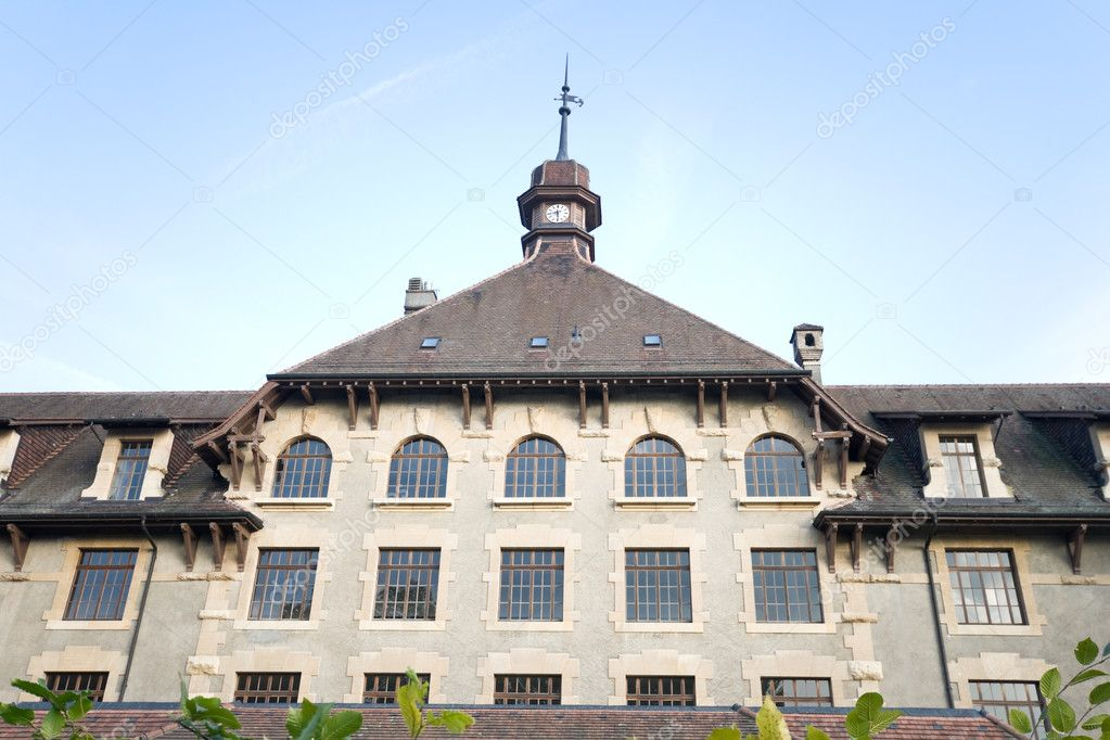 Old Gothic style school building in Geneva, Switzerland.  Shot with a wide angle lens. — Stock Photo #7896328