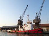 Orange tugboat in a harbor — Stock Photo
