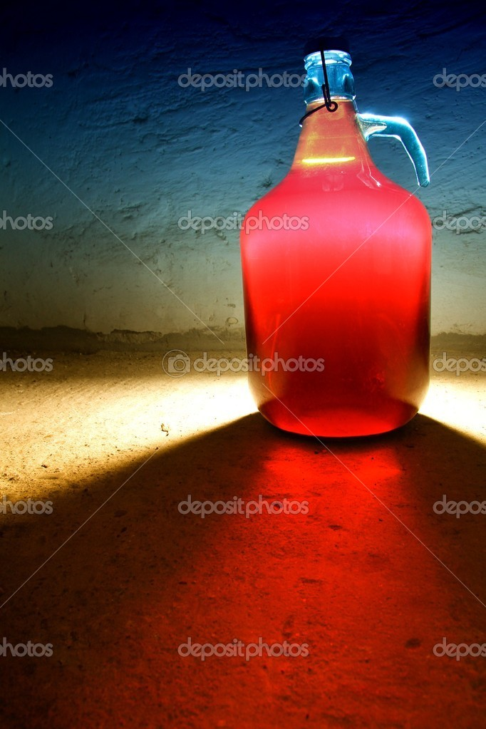 Back lighted bottle of the red red current wine with marked shadow — Stock Photo #7783576