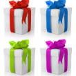 Gift boxes with color bows - Stock Photo