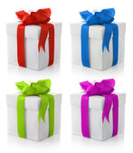 Gift boxes with color bows — Stock Photo