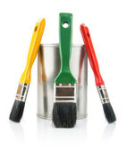 Paint tin with brushes — Stock Photo
