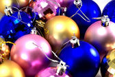 Many Christmas baubles for tree — Stock Photo