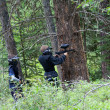 Постер, плакат: Playing Paintball in The Woods