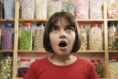 Child in sweet shop — Stock Photo