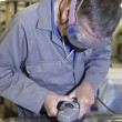 Worker with angle grinder — Stock Photo
