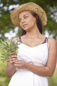 Girl wearing summer hat — Stock Photo
