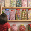 Постер, плакат: Child in sweet shop