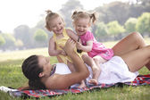 Mother playing with daughters — Stock Photo