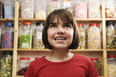 Girl in sweet shop — Stock Photo