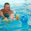 Stock Photo: Baby bathes in a pool