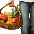 Wicker basket with fruits in female hand — Stock Photo