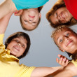 Four friends huddling — Stock Photo