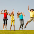 Group of hapy smiling kids or children jumping — Stock Photo