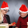 Two nerds in Santa hats — Stock Photo