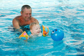 Baby bathes in a pool — Stock Photo