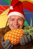 Man with pineapple — Stock Photo