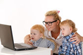 Young mother with two children — Stock Photo