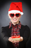 Santa woman with heart shaped glasses — Stock Photo