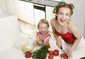 Housewife with daugther — Stock Photo