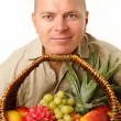 Stock Photo: Mwith fruits in basket