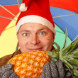 Santa Man with pineapple — Stock Photo