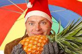 Santa Man with pineapple — Stock Photo