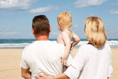Young grandparents with a grandchild in her arms — Stock Photo