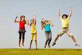 Fun group of kids jumping — Stock Photo