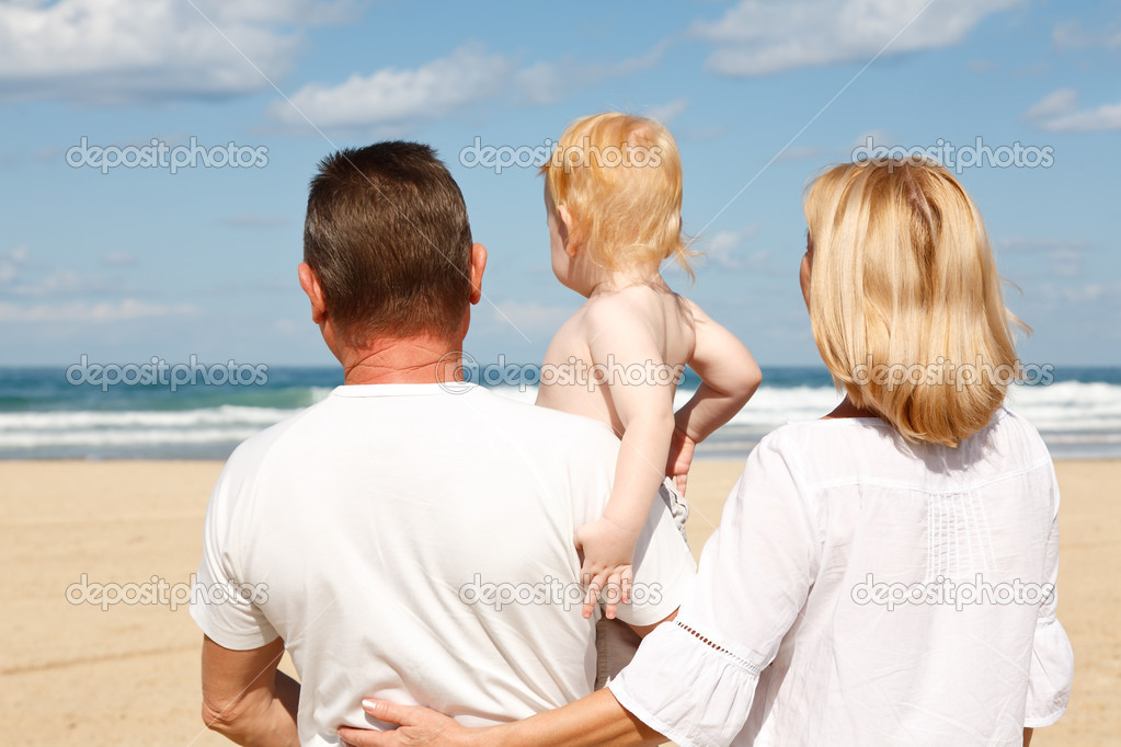 Young grandparents with a grandchild in her arms, on the sea  Stock Photo #7844957