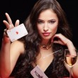 Pretty woman gambling on red table - Stock Photo