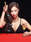 Pretty woman throw the dices — Stock Photo