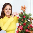 Woman near christmas tree - 图库照片
