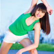 Woman doing exercise outdoors — Stock Photo