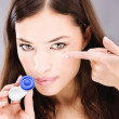 Woman holding contact lenses cases and lens — Stock fotografie