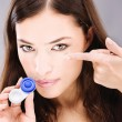 Woman holding contact lenses cases and lens — Stok fotoğraf