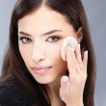 Pretty black hair woman applying make up on her cheek — Stock Photo #7796912