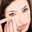 Woman putting contact lens in her eye — Stock Photo