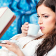 Woman enjoy cup of coffee in spa center — Stock Photo
