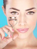 Pretty woman holding tool for eyelash — Stock Photo