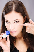 Woman holding contact lenses cases and lens — Stock Photo