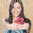 Happy girl with red orchid under water drops — Stock Photo