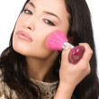 Young pretty girl makeup with powder brush — Stock Photo #7889019